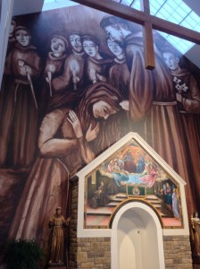 in 2014 we installed a printed image and a painted canvas image onto the altar wall of the new Sisters of Saint Clare sanctuary.  We didn't create the images but we were proud to have mastered installation techniques enough to serve other artists.